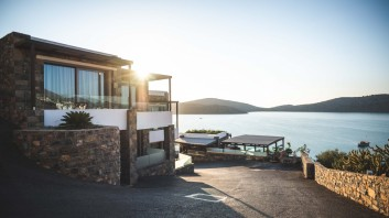 Sun Piercing of Brown Concrete House Near Sea
