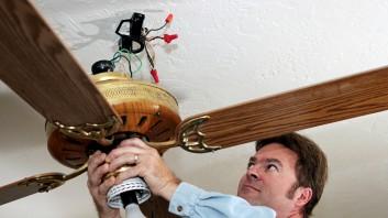 electrician installing fan